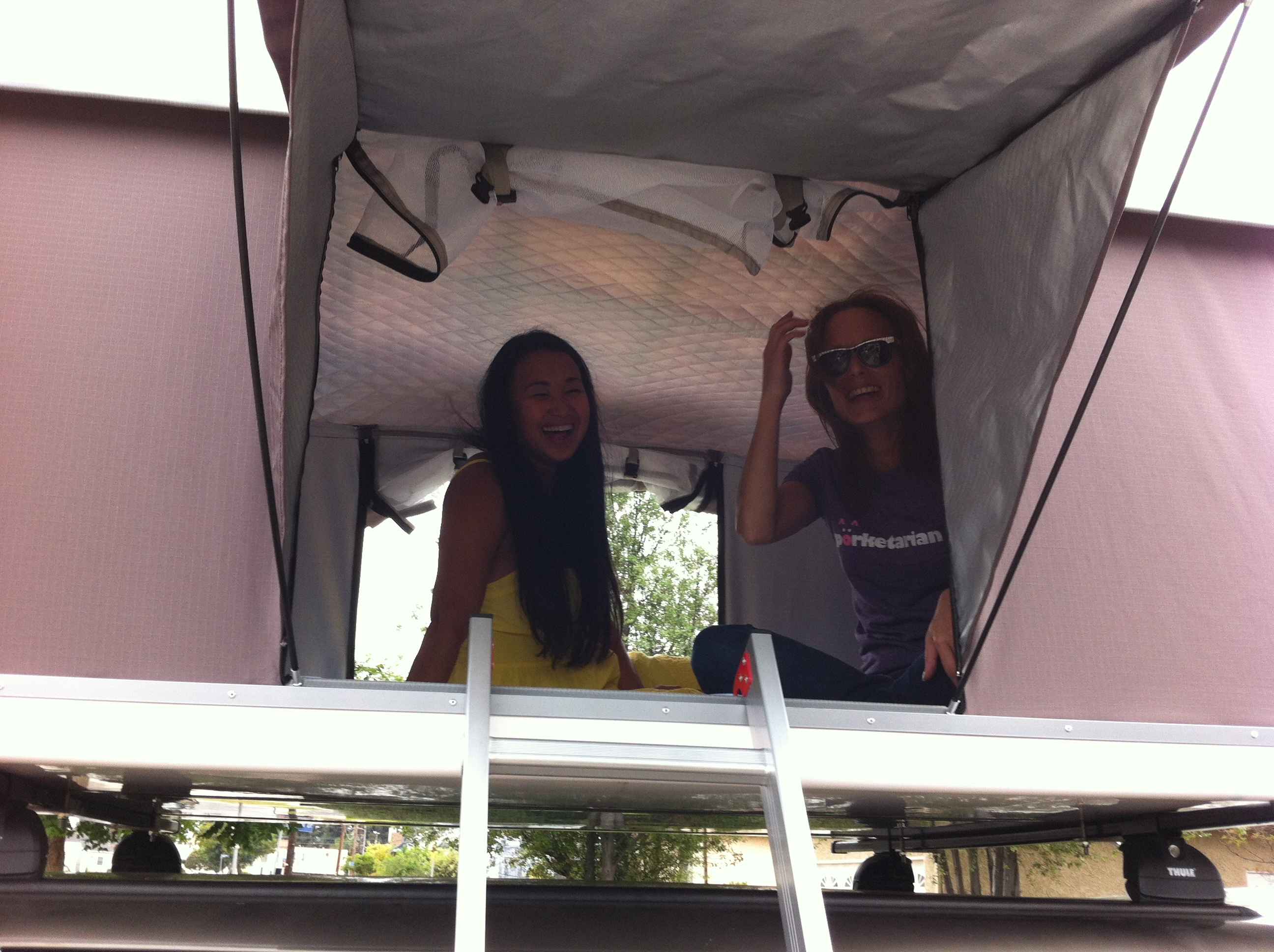 Two Ladies chatting in a Roof Top Tent